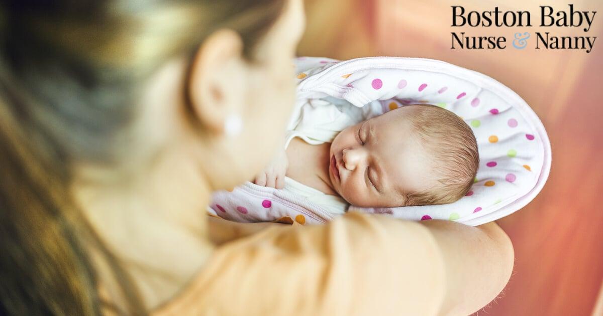 newborn care specialist holding baby