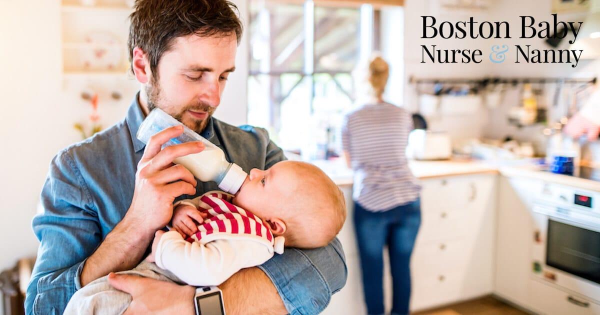 dad feeding baby bottle