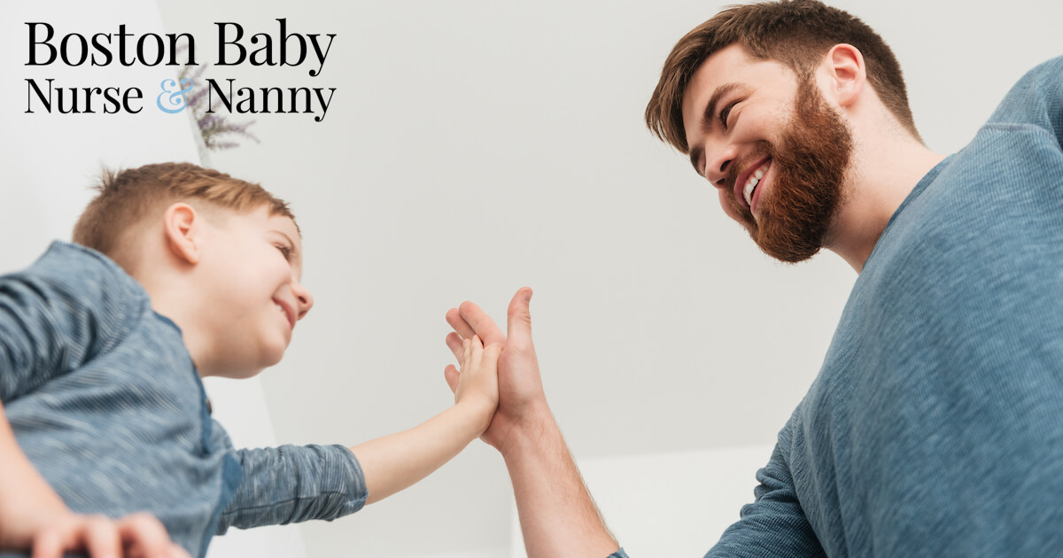 son and father high five