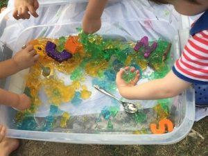 kids squishing jello