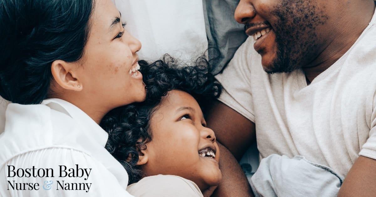 mom, dad, and child hugging