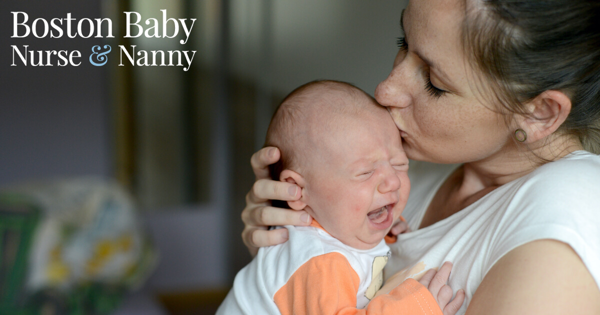 mom kissing crying baby
