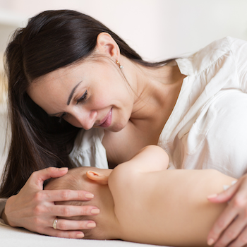 mother lying down breastfeeding